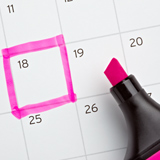 Picture of a calendar with one day highlighted in pink