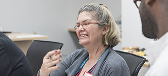 A Health Quality Ontario employee participates in a group discussion